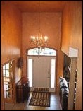 This foyer was a color wash over knockdown texture.