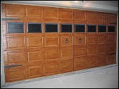 This was done on a raised panel steel garage door.  The windows, hinges, handles and rivets are all painted to look 3 dimensional.