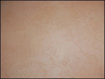 This is a subtle Color Wash over a textured wall to give the texture more depth.